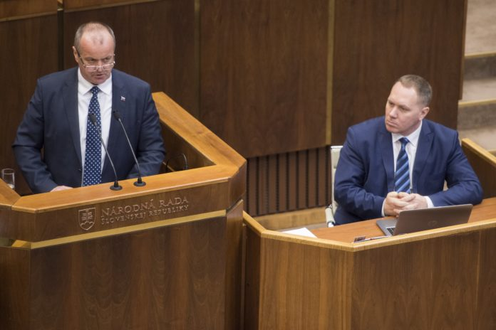 92cdb60e7 Defence Minister Peter Gajdos (L) and MP Richard Vasecka (OLaNO) during  deliberations in the Parliament on February 9, 2018 (photo by TASR)